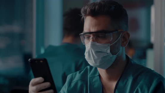 Thumbnail for Doctor Browsing Smartphone in Laboratory