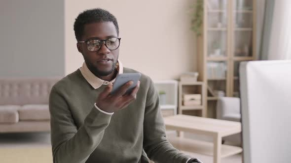 Young African Businessman Recording Voice Message