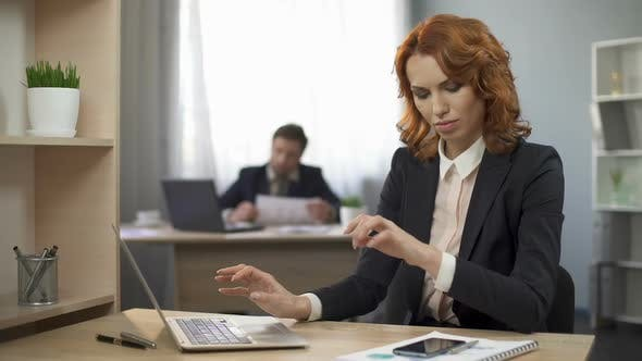 Thumbnail for Woman Typing on Laptop, Taking Cellphone to Check Information, Company Employee