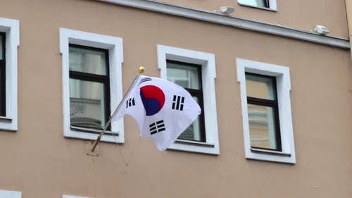 The Flag of South Korea on the Flagpole is Installed on the Building