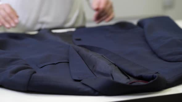 Thumbnail for Hands of Dry-cleaning Worker Inspecting Jacket