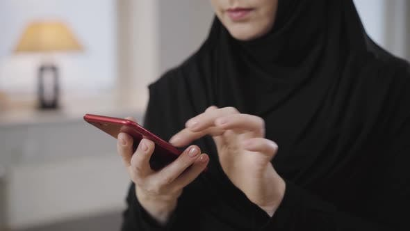 Thumbnail for Female Hands with Beautiful Manicure Scrolling on Smartphone, Young Unrecognizable Muslim Woman
