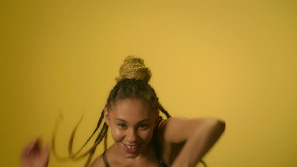Thumbnail for African Woman with Afro Hairstyle Dancing Hip Hop Dance on Yellow Wall