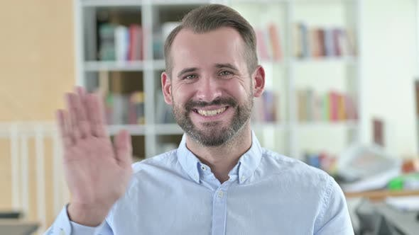 Thumbnail for Portrait of Cheerful Young Man Waving