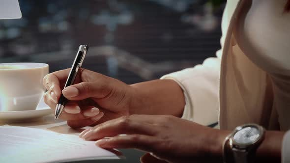Thumbnail for Close Up of African American Woman's Hands Signing Agreement