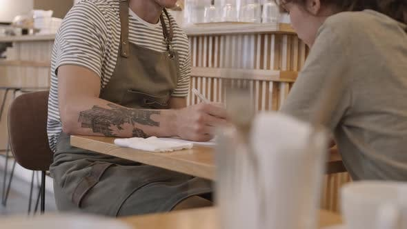 Thumbnail for Two Caterers Discussing Business and Writing