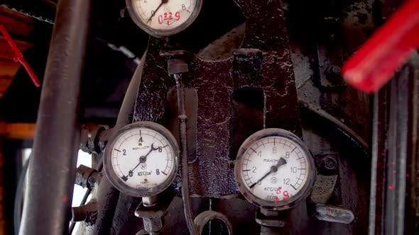 Thumbnail for Dolly Video of Lots of Pipes, Valves and Gauges in Old Steam Locomotive Train Cabin.