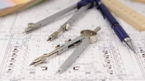 On the Table Is a Drawing for Builders and Stationery. Close Up