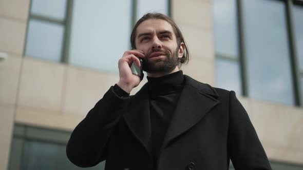 Businessman Speaking By the Phone
