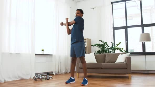 Thumbnail for Man with Fitness Tracker Stretching Body at Home