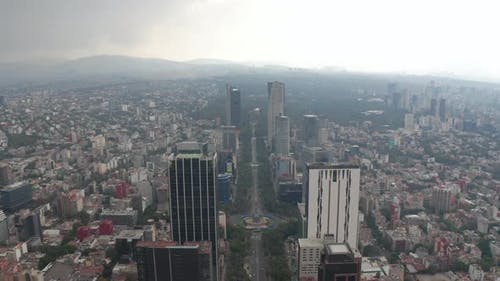 Aerial View of Straight Boulevard Surrounded By Tall Modern Office Buildings