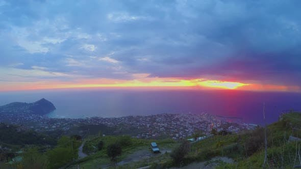 Cover Image for Wonderful Ocean Sunset, View on City From Mountain Peak, Heavy Clouds Timelapse