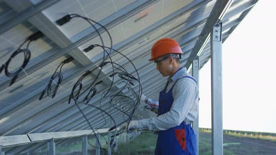 Thumbnail for Workers Connecting Wires of Solar Panels