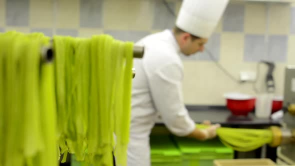 Production of Pasta - Machine Produce Pasta - Chef Makes Pasta (Pull Out From Machine)