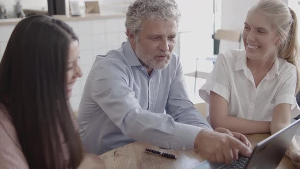 Thumbnail for Senior Grey-haired Businessman Typing on Laptop Keyboard