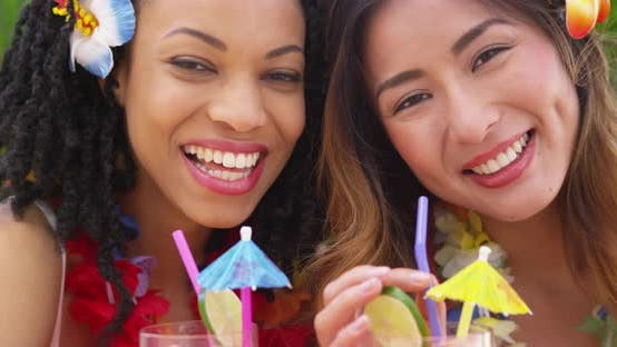 Thumbnail for Close up of happy beautiful Asian and Black friends on vacation