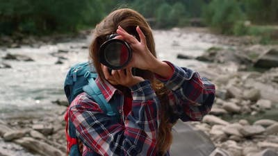 Girl Photographing in Mountains