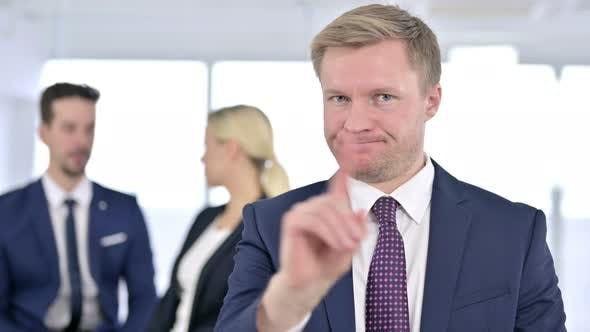 Thumbnail for Portrait of Serious Businessman Saying No By Finger Sign