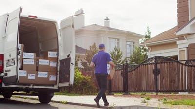 Courier Delivering Package and Making Phone Call