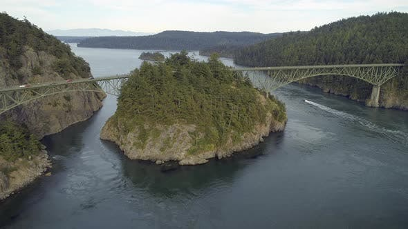 Thumbnail for Aerial Film Of Boat Traveling Under Deception Pass Bridge