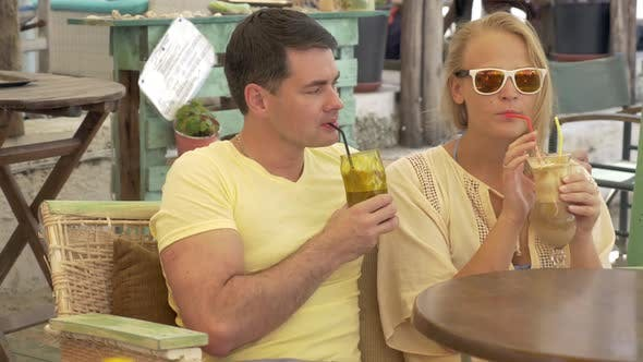 Thumbnail for Couple Drinking Ice Coffee and Talking