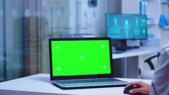 Thumbnail for Healthcare Practitioner Using Laptop with Green Screen