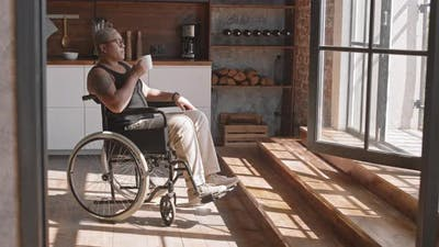 Handicapped Woman Drinking Coffee