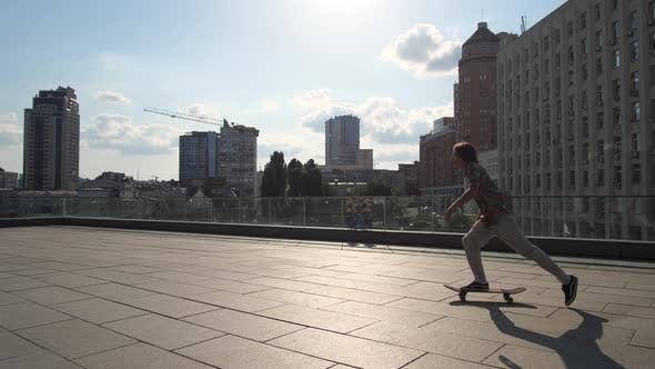 Thumbnail for Skillful Male Skater Riding Skateboard in City