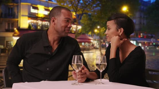 Thumbnail for African woman surprised by boyfriend's marriage proposal on romantic night out