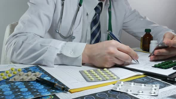 Thumbnail for Young Doctor Fills In A Prescription For Medicines In A Hospital