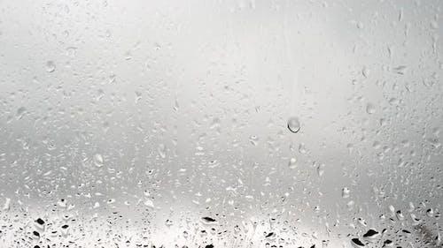 Raindrops On Transparent Glass, Thunderstorm Outside The Window, Beautiful Rain Background.
