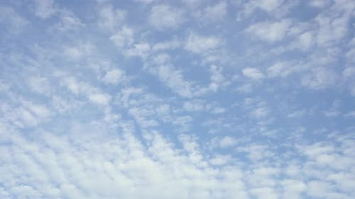 Cirrus clouds move smoothly in the blue sky