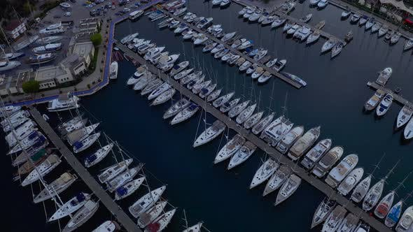Thumbnail for Fly Over an Elite Yachts Moored in the Port Eary in the Morning. View From Above