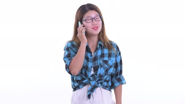 Thumbnail for Happy Young Asian Hipster Woman Talking on the Phone