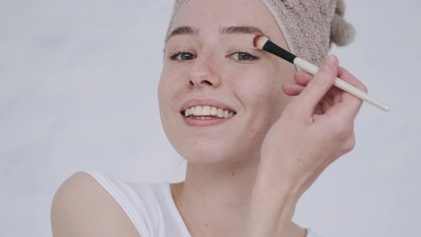 Thumbnail for Female in a Bathrobe with Cosmetics