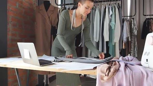 Caucasian Fashion Designer Working in Studio