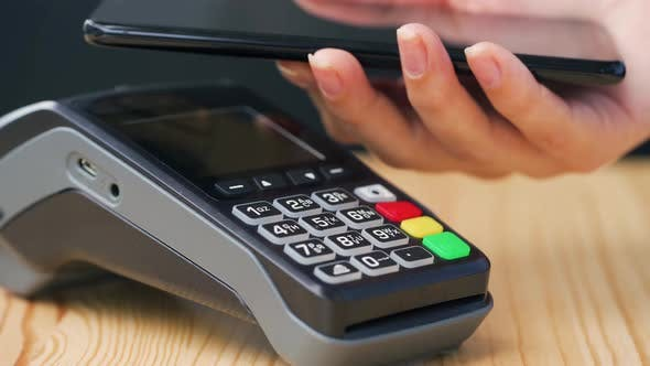 Thumbnail for Contactless Payment with Smartphone. Wireless Payment Concept. Close-up, Woman Using Smartphone