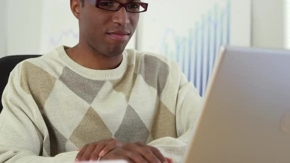 Thumbnail for Black business man working at laptop computer