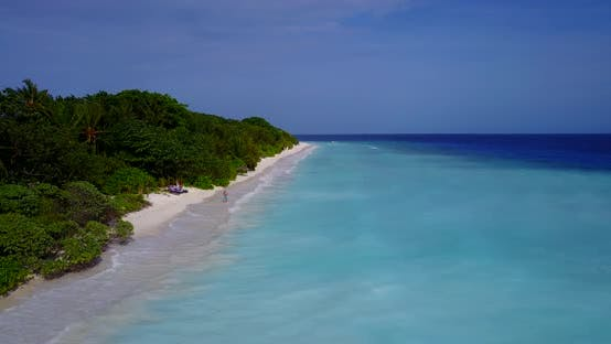 Thumbnail for Wide drone travel shot of a white sandy paradise beach and aqua turquoise water background in 4K