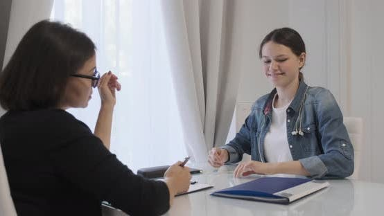 Thumbnail for Woman Professional Psychotherapist, Psychologist Talking with Teen Girl in Office