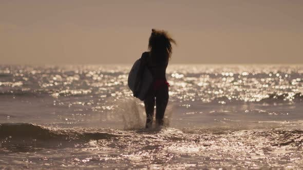 Thumbnail for The Girl Running in the Sea with Bodyboarding To the Waves