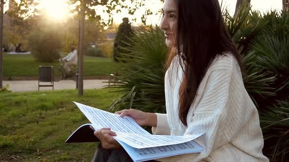 Thumbnail for Slow Motion Studying Happy Young Woman Reading Her Book for School. Beautiful Mixed Race Asian