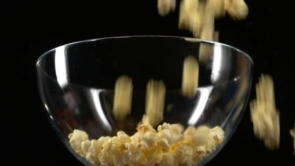 Thumbnail for Popcorn Falling in Glass Bowl on Black, Slow Motion