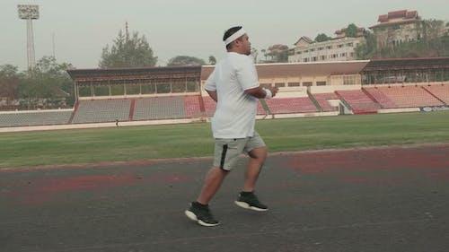 Fat Man Running For Exercising