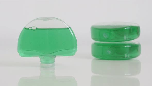 Thumbnail for Green gel bowl fresheners on white slow tilt 4K footage