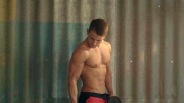 Thumbnail for Muscular Bodybuilder Guy Doing Exercises with Dumbbells