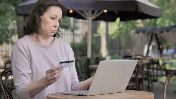 Thumbnail for Online Shopping Failure for Old Woman Sitting Outdoor