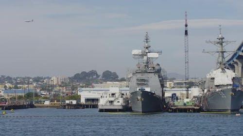 Navy ships anchored near a bridge