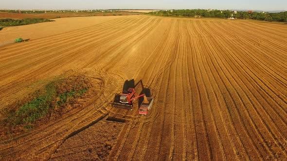 Harvester in a Golden Field