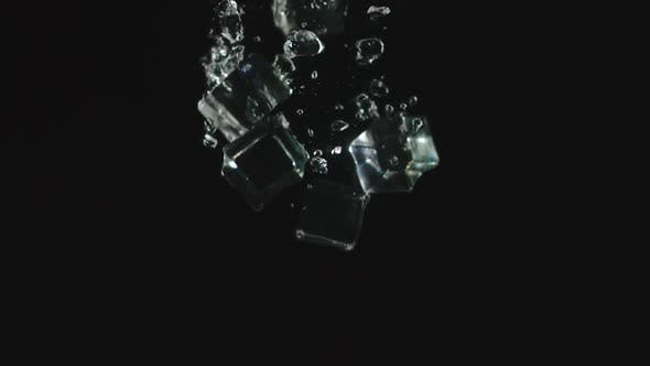 Thumbnail for Ice Cubes Fall In Water